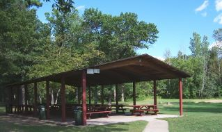 A large red wooden pavilion.