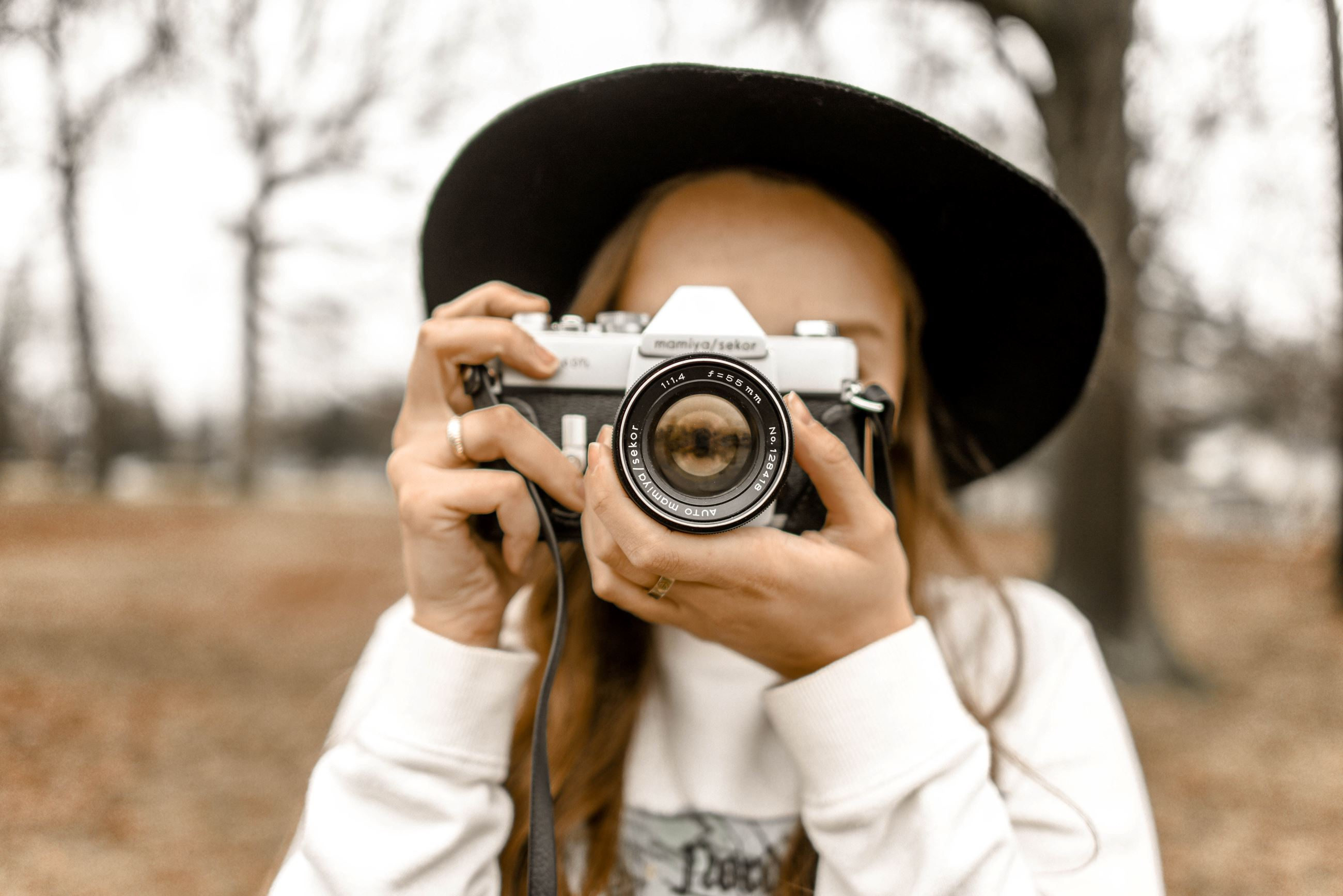 Canva - Selective Focus Photography of Woman Using White and Black Slr Camera