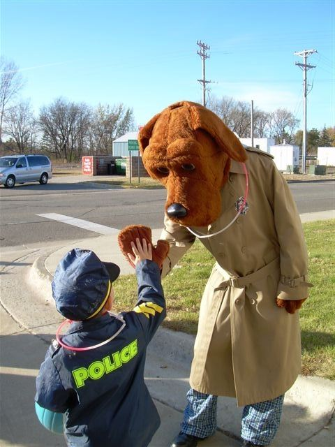 McGruff the Crime Dog High-Fiving a Boy