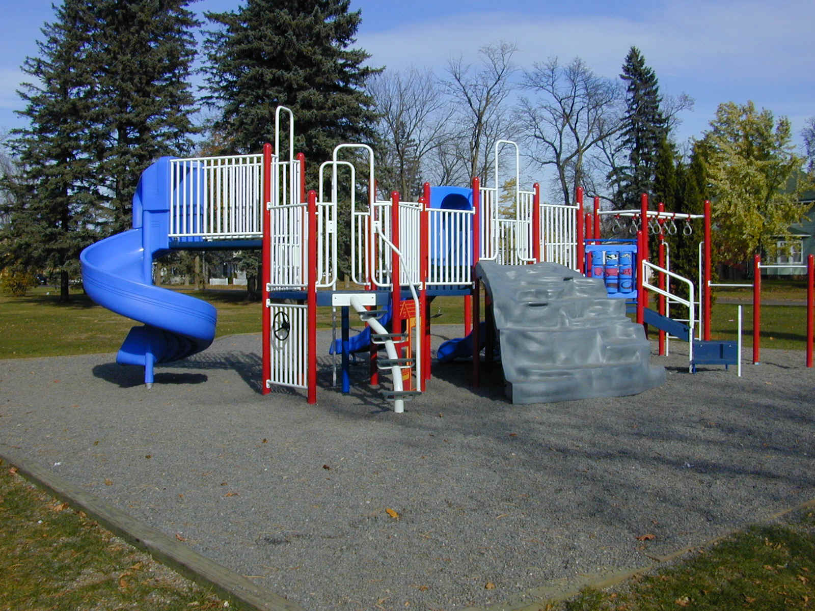 Red, white, and blue playground equipment.