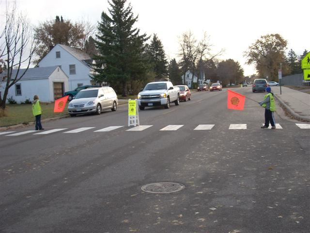 School Safety Patrol Volunteers Stopping Traffic